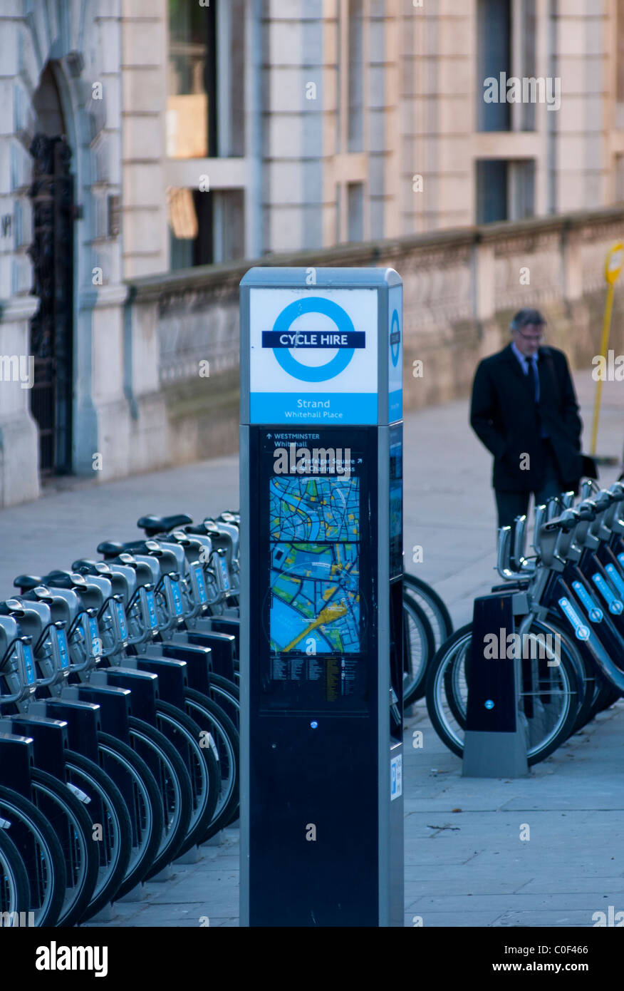 Pay station and rows of bikes for the new Mayoral TFL initiative London bicycles for hire, seen in Knightsbridge, - Stock Image
