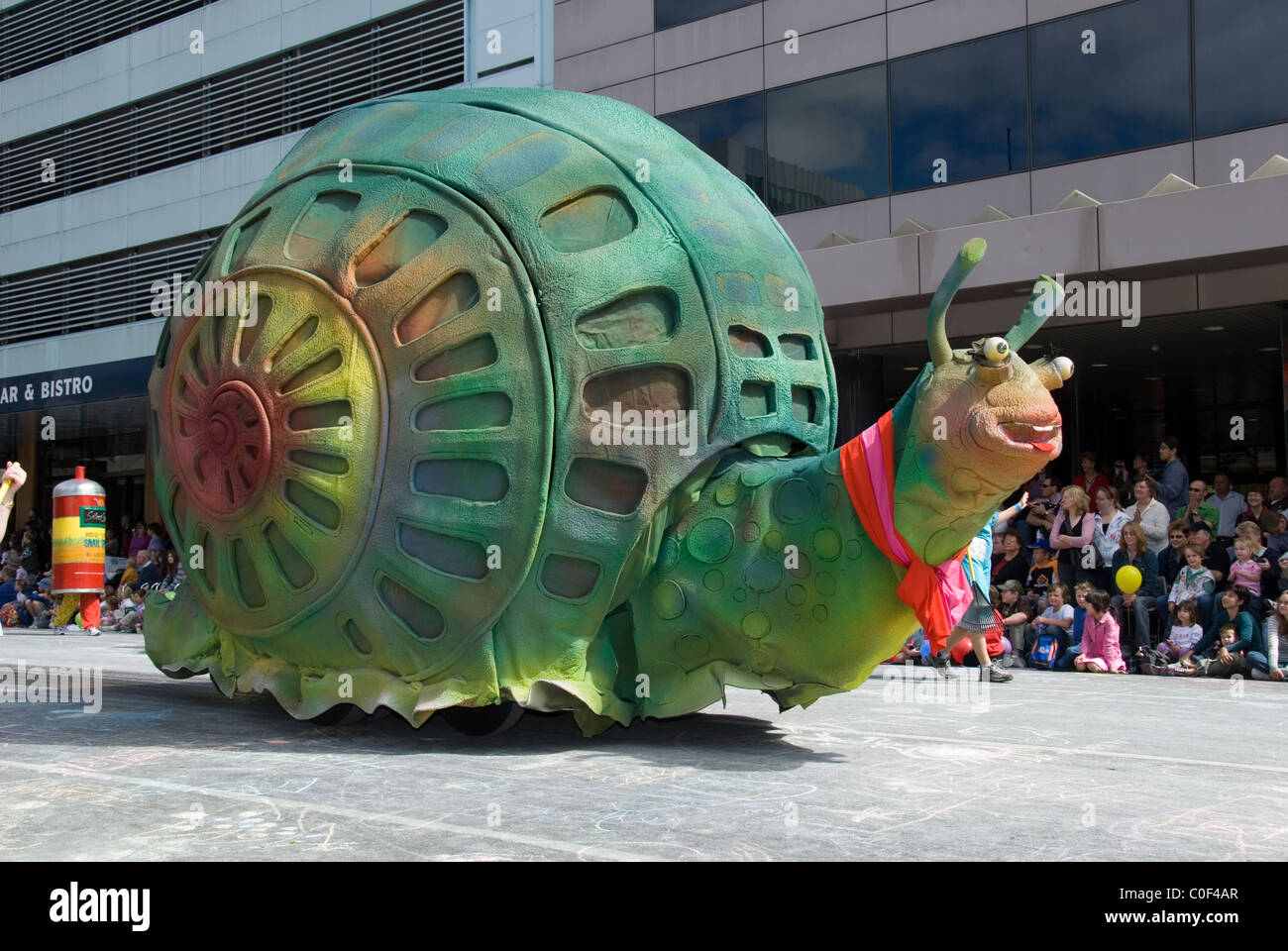 Large snail float in the Credit Union Christmas Pageant through the streets of Adelaide, South Australia. - Stock Image