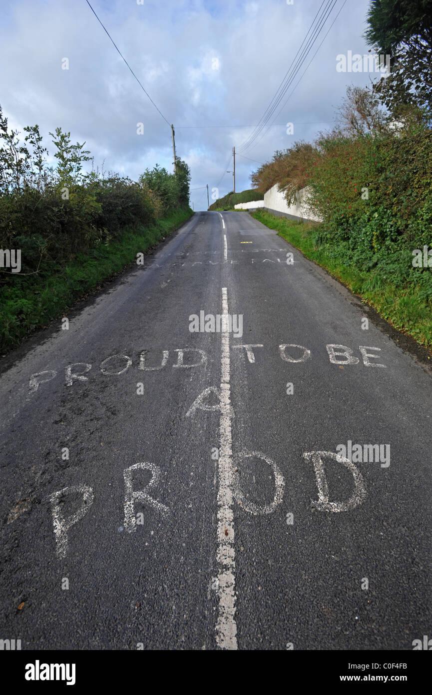 Loyalist graffiti on road, Ballycarry, County Antrim, Northern Ireland. - Stock Image