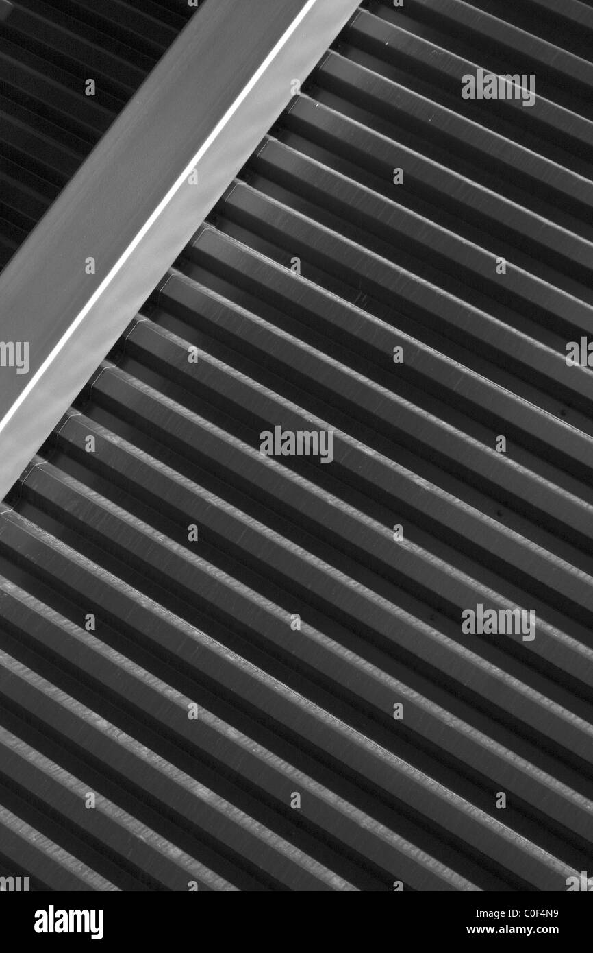Metal strips on the modern wall - Stock Image