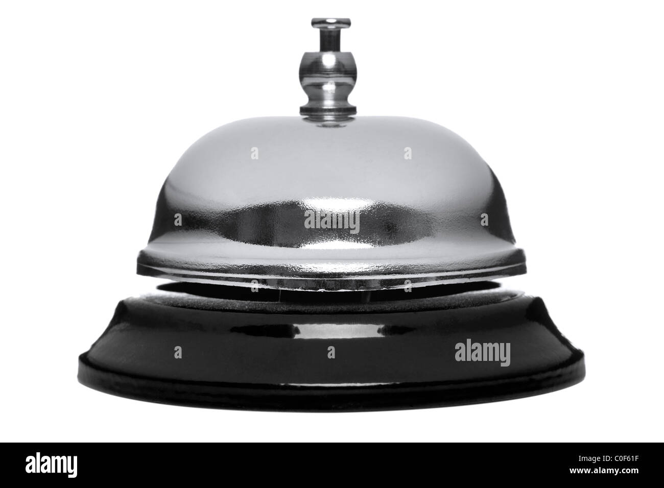 Photo of a chrome reception bell isolated on a white background. - Stock Image