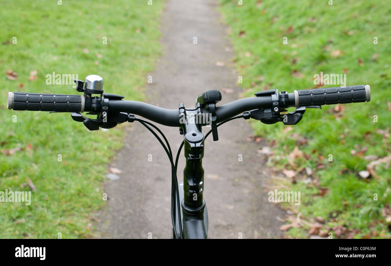 Bicycle Handlebars with Path in Background - Stock Image