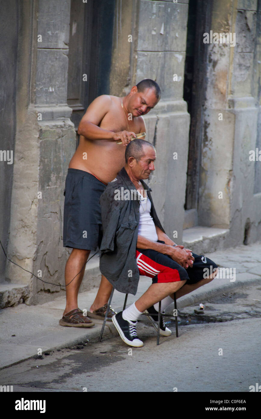Street scene in Havann Viejo,open air hair cutter, Havanna Cuba Stock Photo