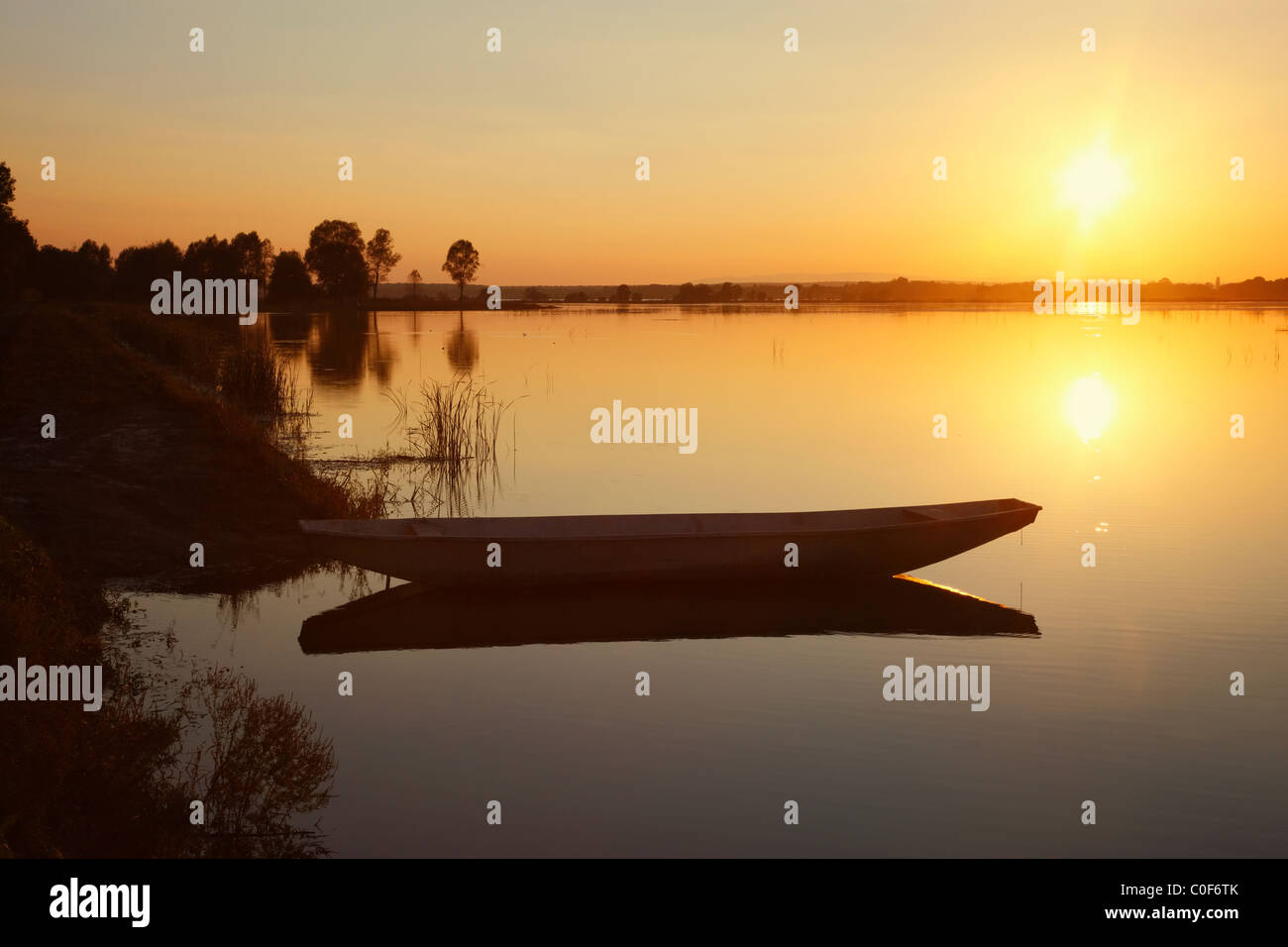 River boat at sunset. - Stock Image