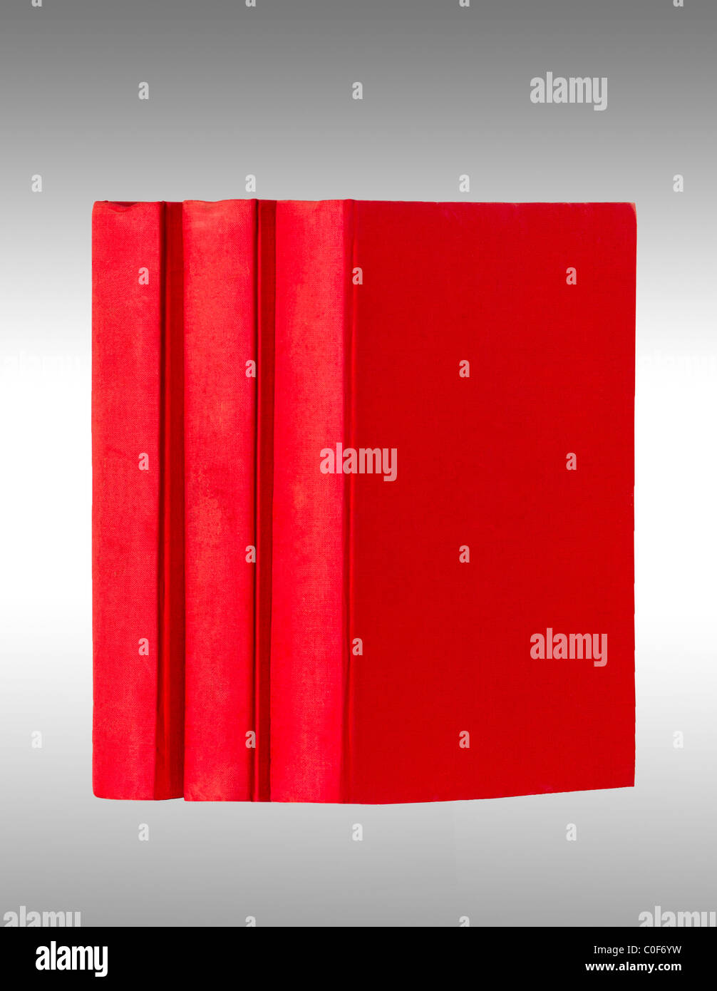 three red books untitled on a neutral background - Stock Image