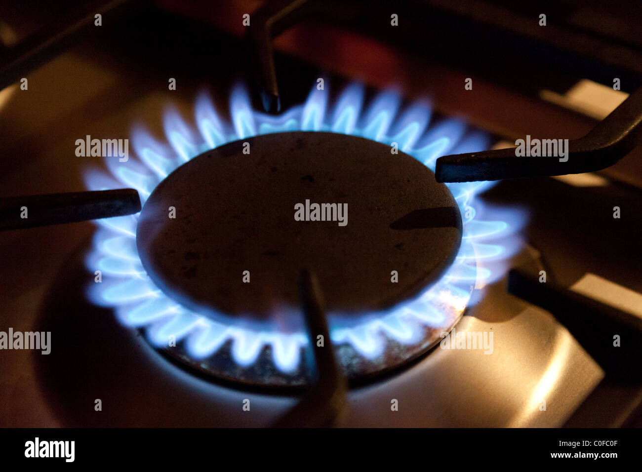 Gas ring on stove hob - Stock Image