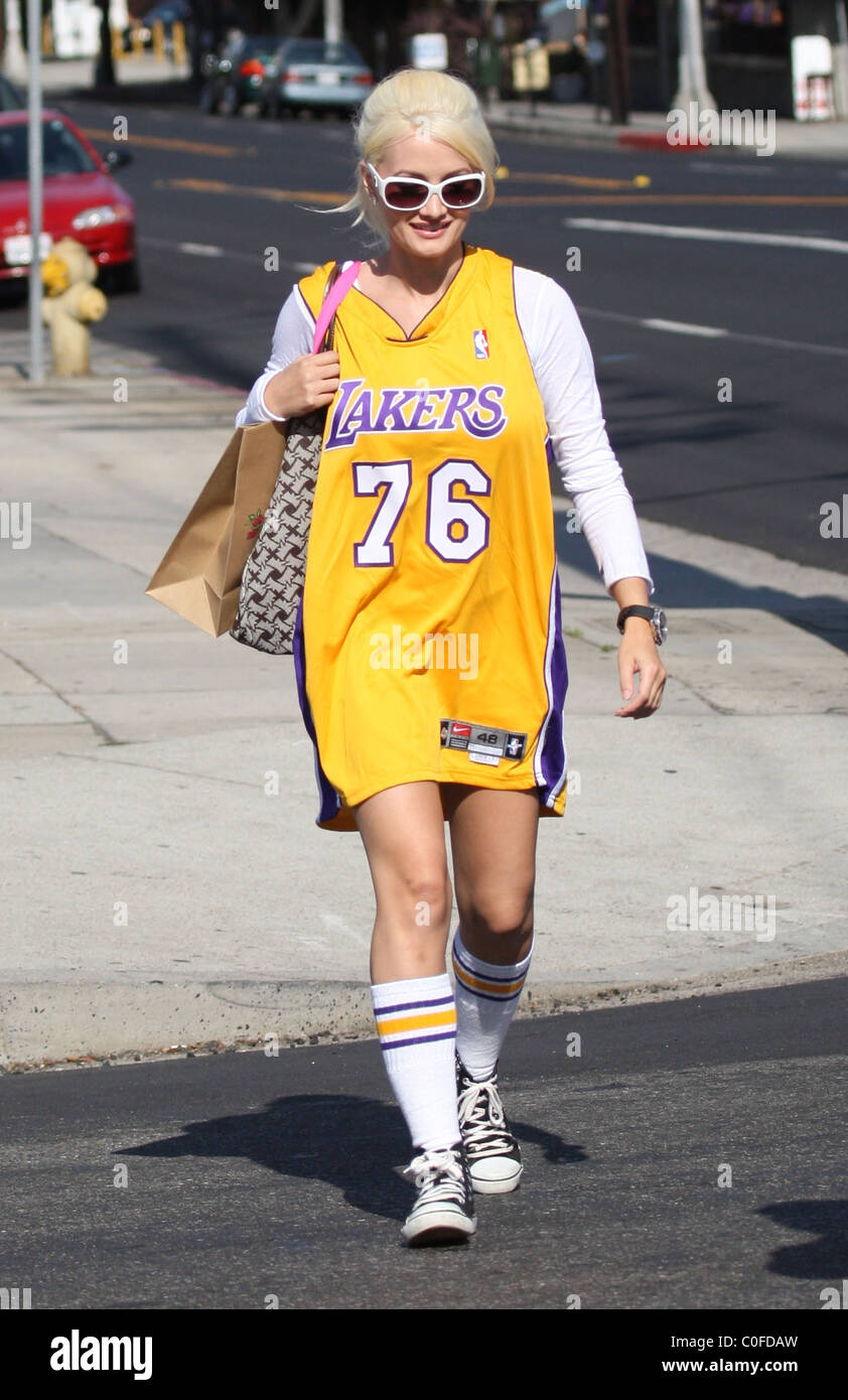 42e1b639eff Holly Madison shows her team pride by wearing a Los Angeles Laker  basketball jersey as she