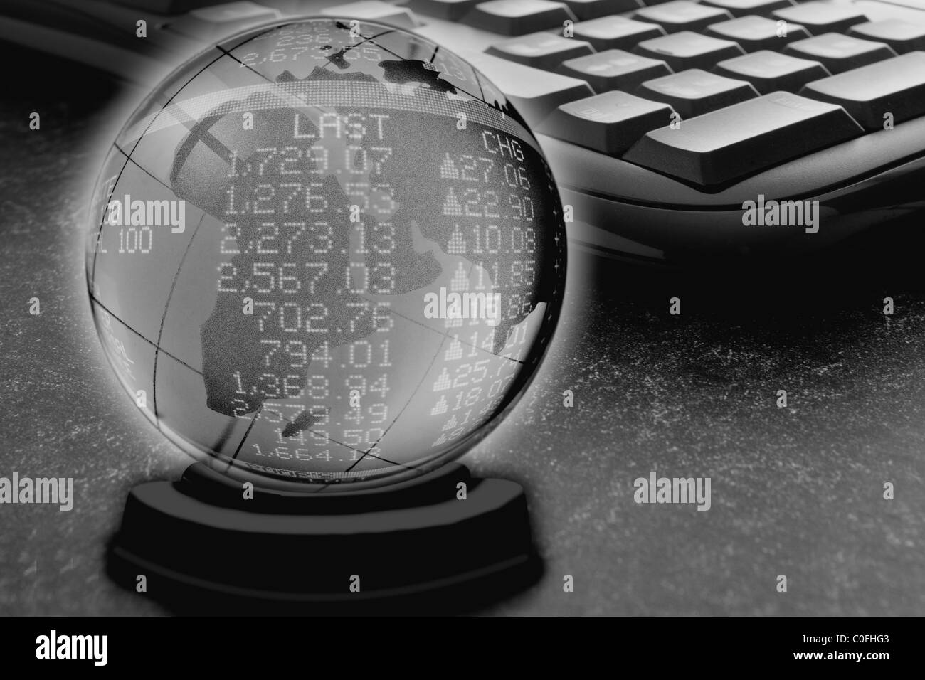 Crystal ball containing a world globe overlaid with a stock market tally board portraying the concept of global - Stock Image