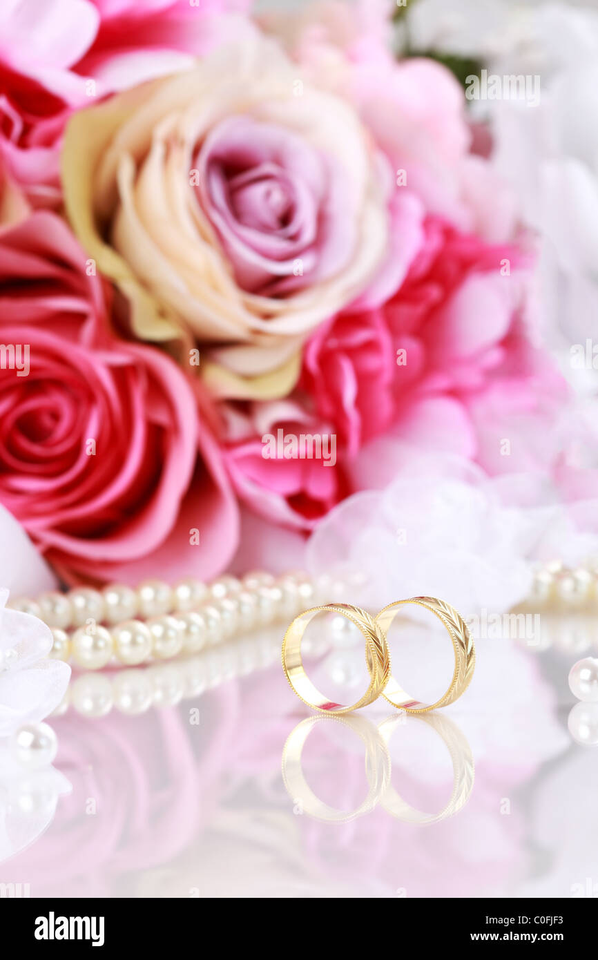 Wedding still life with beautiful golden rings and bouquet Stock ...