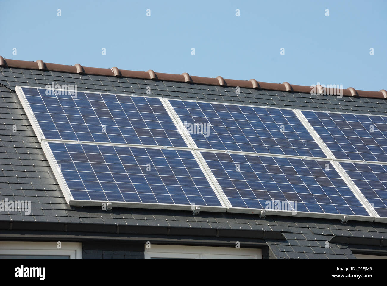 House with solar panels on roof - Stock Image