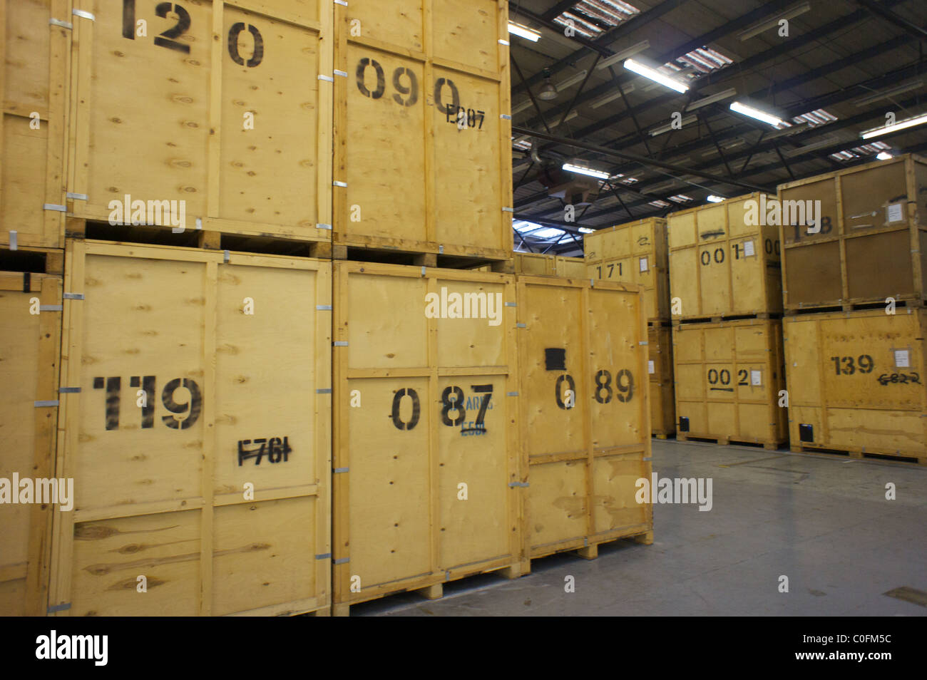 Wooden Storage Containers Stacked In A Warehouse In London   Stock Image