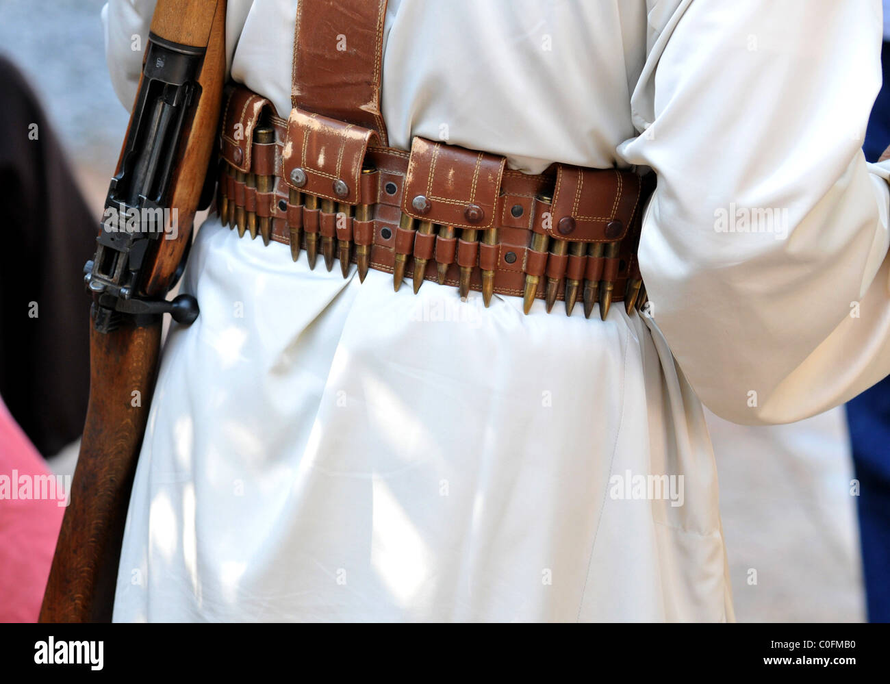Lee Enfield 303 rifle and bullet belt. - Stock Image