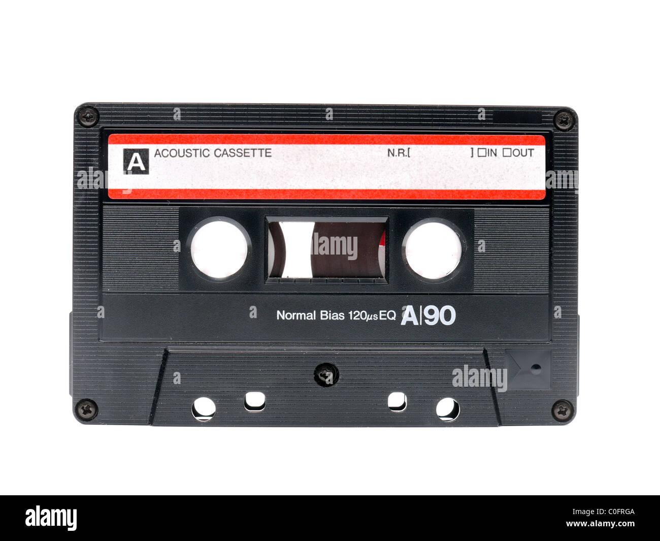 Old audio cassette tape shot over white background - Stock Image