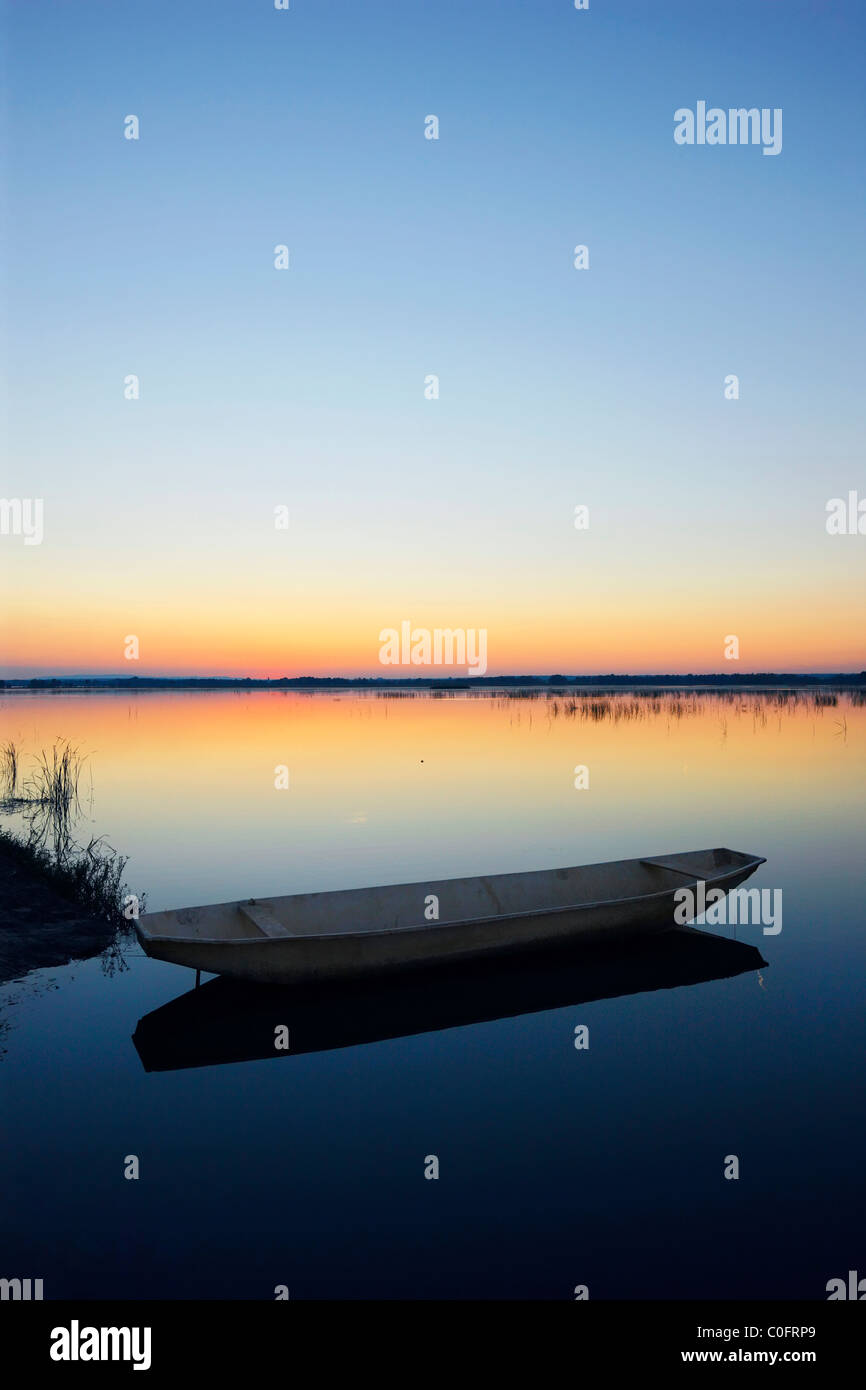 Fishing boat at sunset. - Stock Image