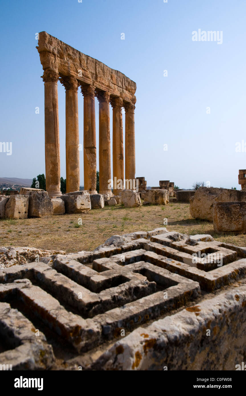 Swastika cross carved in a stone and the Temple of Jupiter, Baalbek,UNESCO World Heritage Site. Bekaa valley. Lebanon. - Stock Image