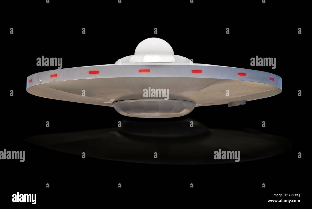UFO saucer with white dome top. - Stock Image