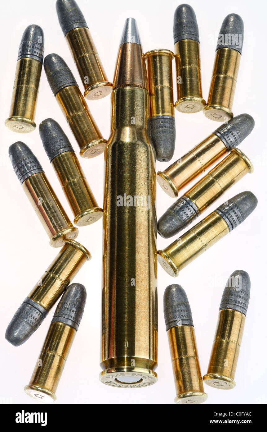 Winchester 30 06 Springfield cartridge and 22 calibre lead rifle bullets on white background - Stock Image