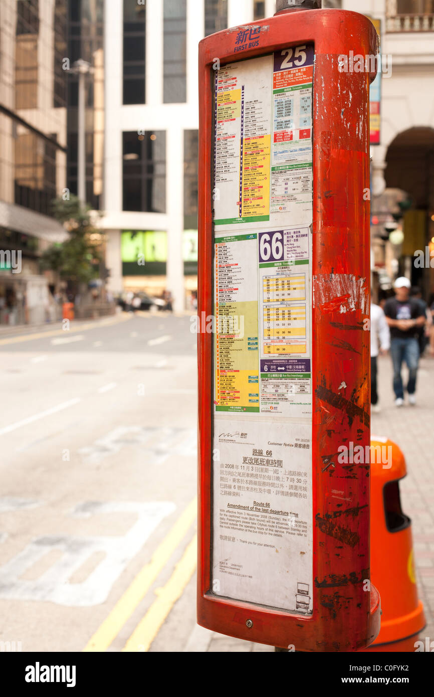 Sign for routes at a bus stop in Central Hong Kong, China - Stock Image