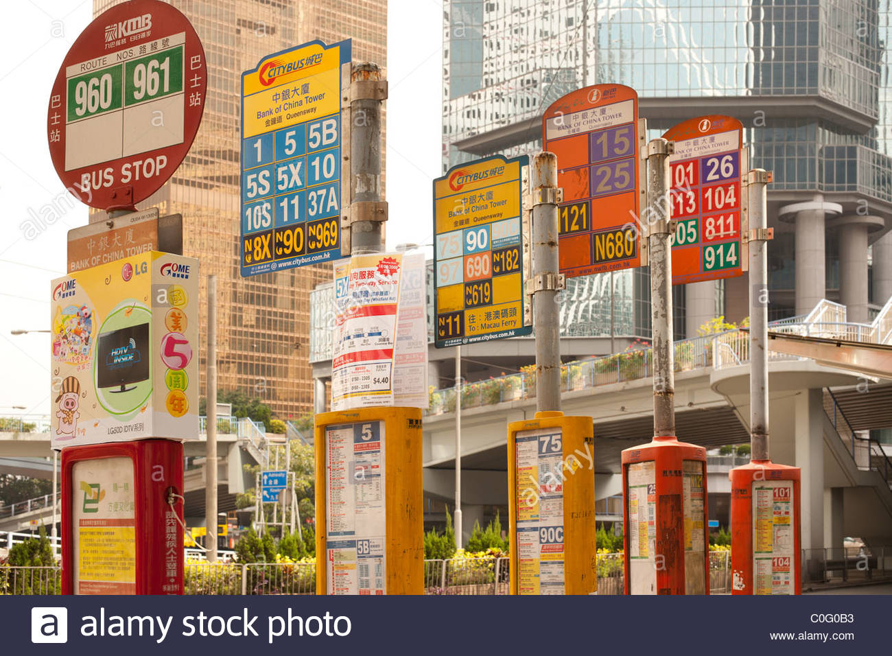 Signs for routes at a bus stop in Central Hong Kong, China - Stock Image