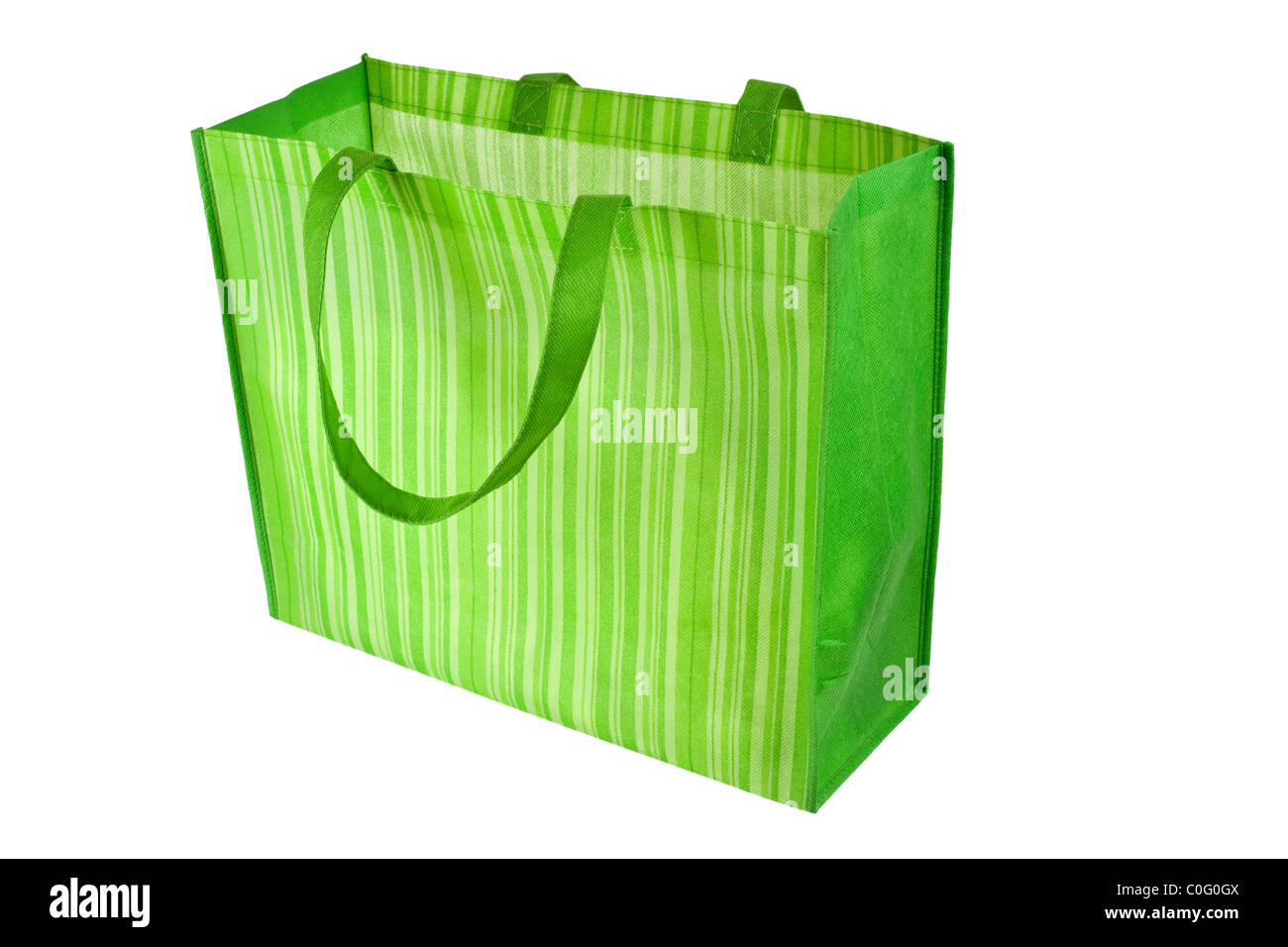 Empty green reusable shopping bag isolated on white background - Stock Image