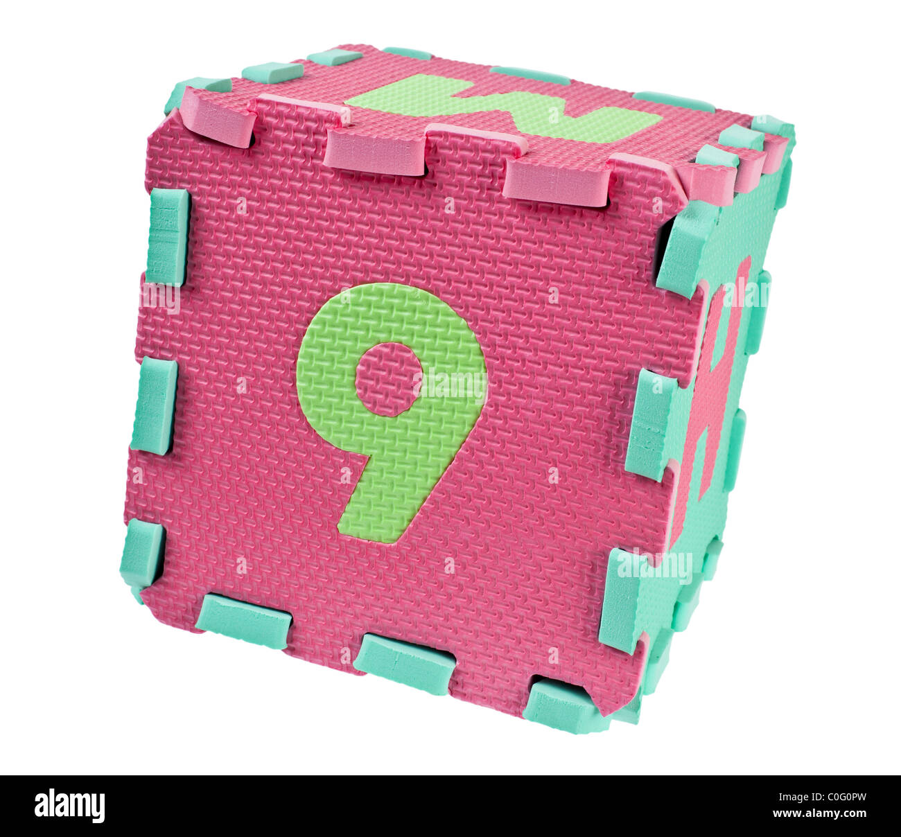 Toy blocks forming a cube with the number nine isolated on white background - Stock Image