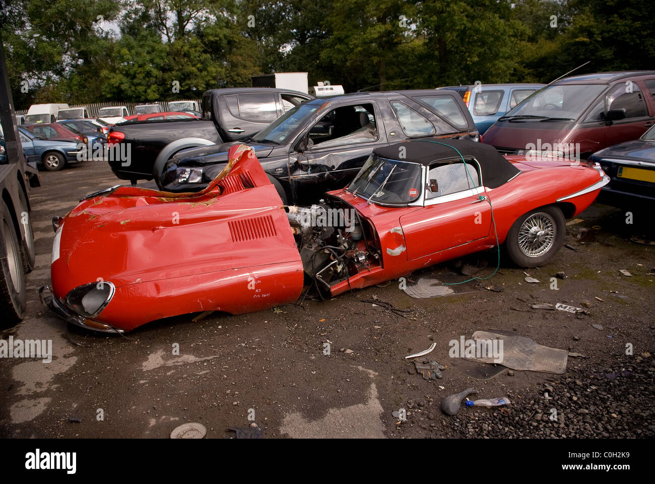 Crashed E Type Jaguar In A Recovery Yard In West Sussex Uk Stock