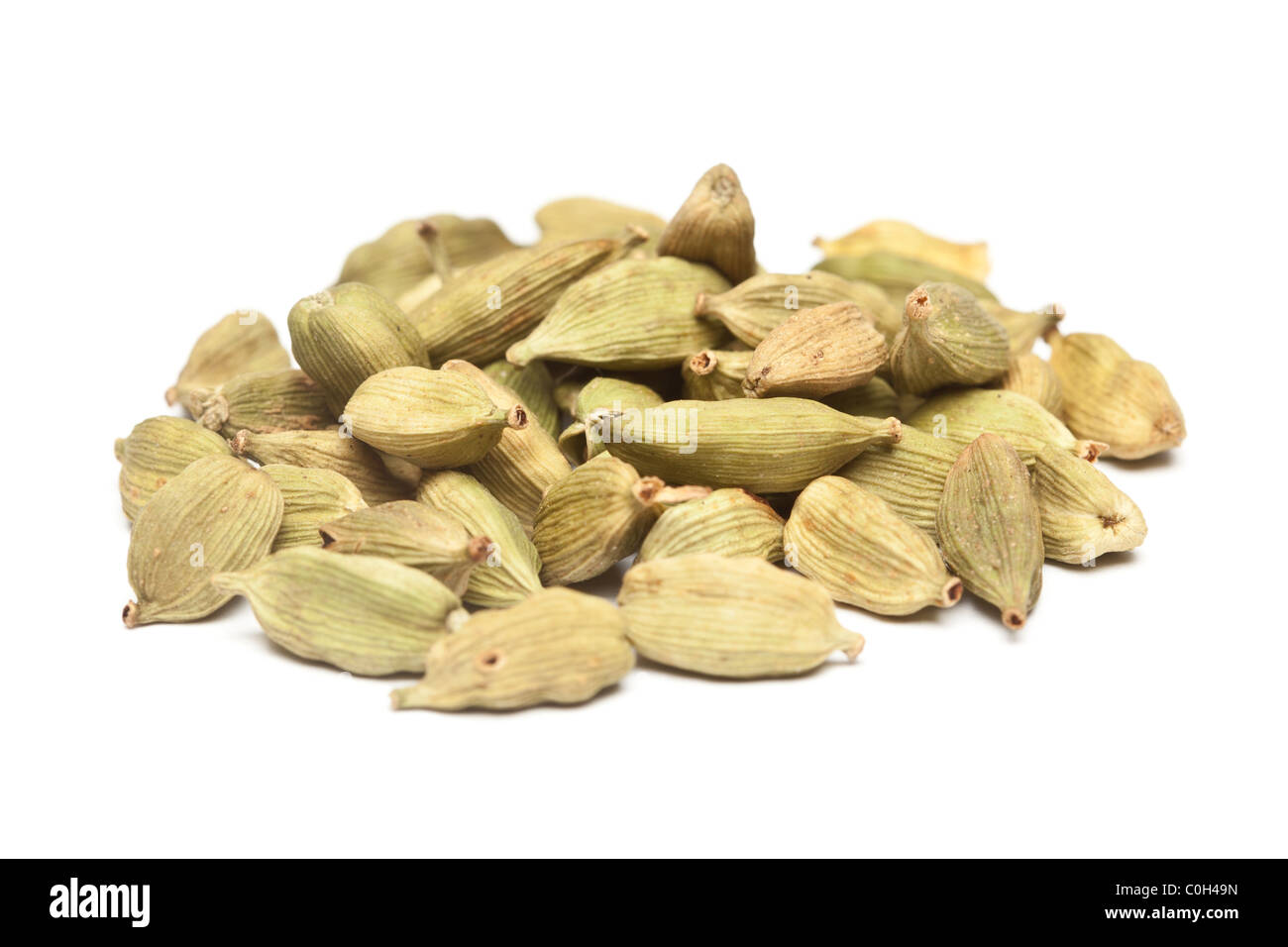 Cardamom pods on a white background. - Stock Image