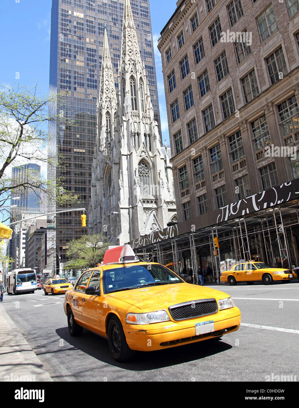 New York city street scene with St Patricks and yellow cabs - Stock Image