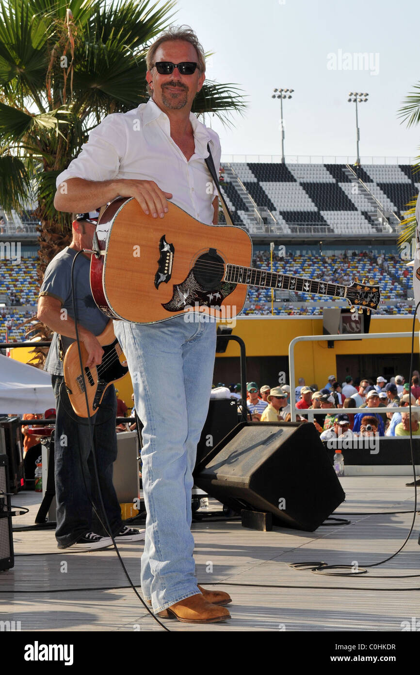 Kevin Costner and Modern West  perform at the NASCAR Sprint Cup Series Coke Zero 400 at Daytona International Speedway. Stock Photo