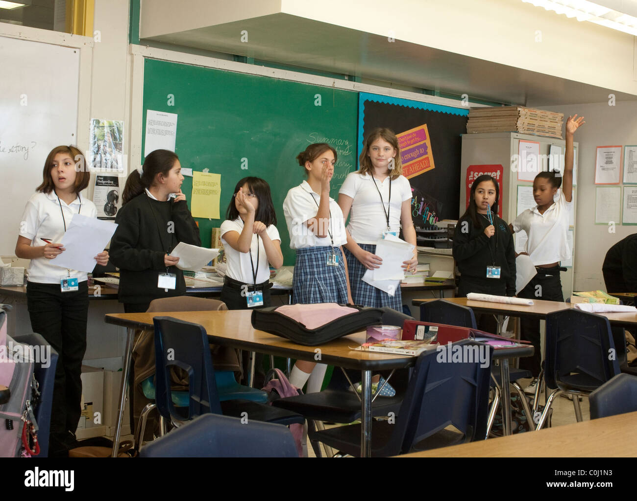 Multi-cultural group of students in a middle school classroom at Ann Richards School for Young Women Leaders in - Stock Image
