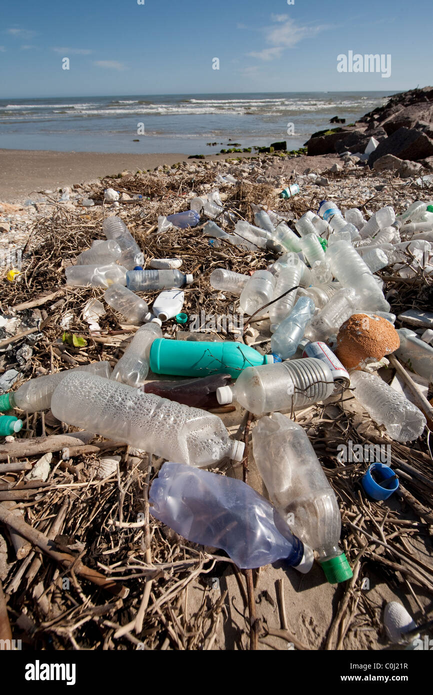 Plastic bottles litter the beach on an isolated part of South Padre Island on the Gulf of Mexico near Port Mansfield, - Stock Image