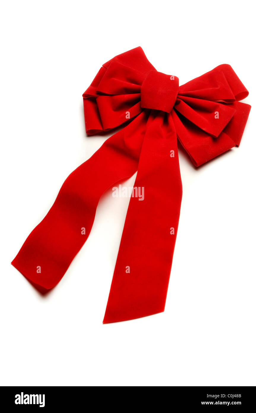 red fabric Christmas bow on white - Stock Image