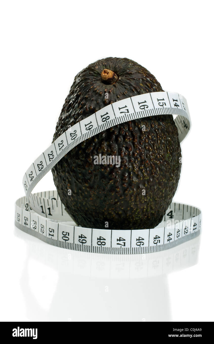 A Mexican Hass Avocado With A Metric Tape Measure, Concept For Healthy Eating - Stock Image