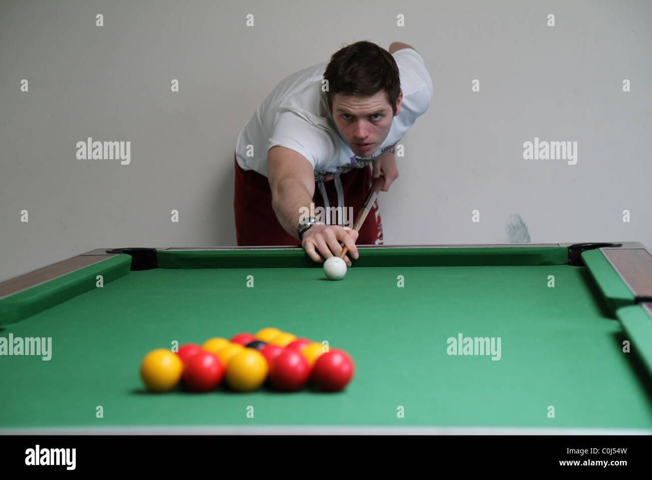 Man playing pool, billiards taking the brake, - Stock Image