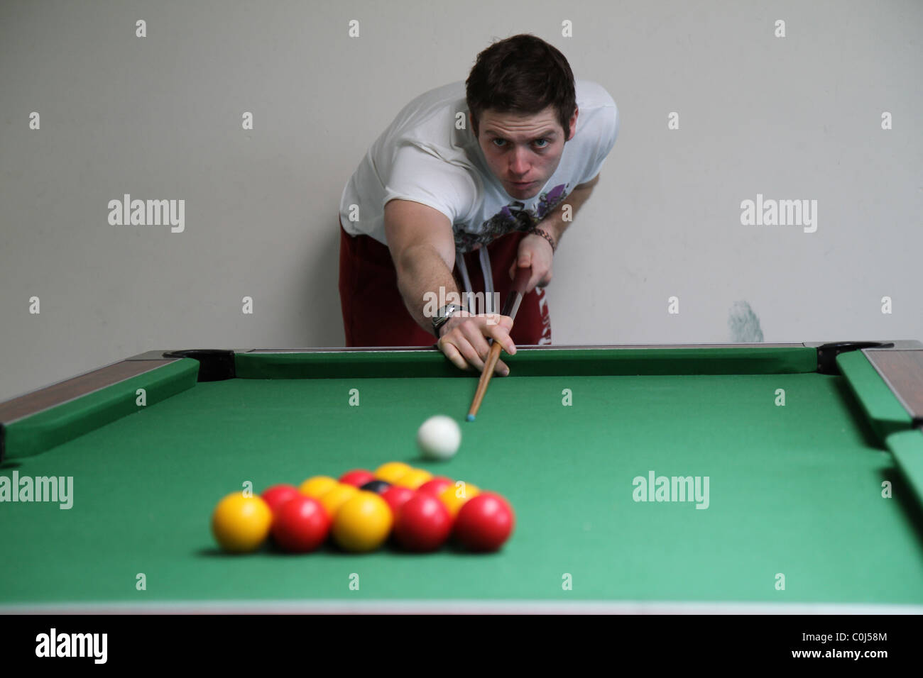 Man playing pool, billiards taking  the brake - Stock Image