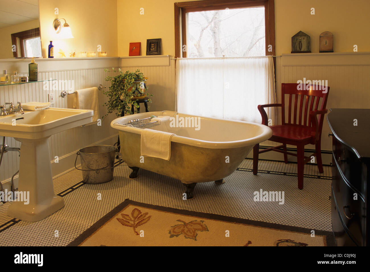 OLD-FASHIONED CAST-IRON CLAWFOOT BATHTUB AND PEDESTAL SINK IN Stock ...