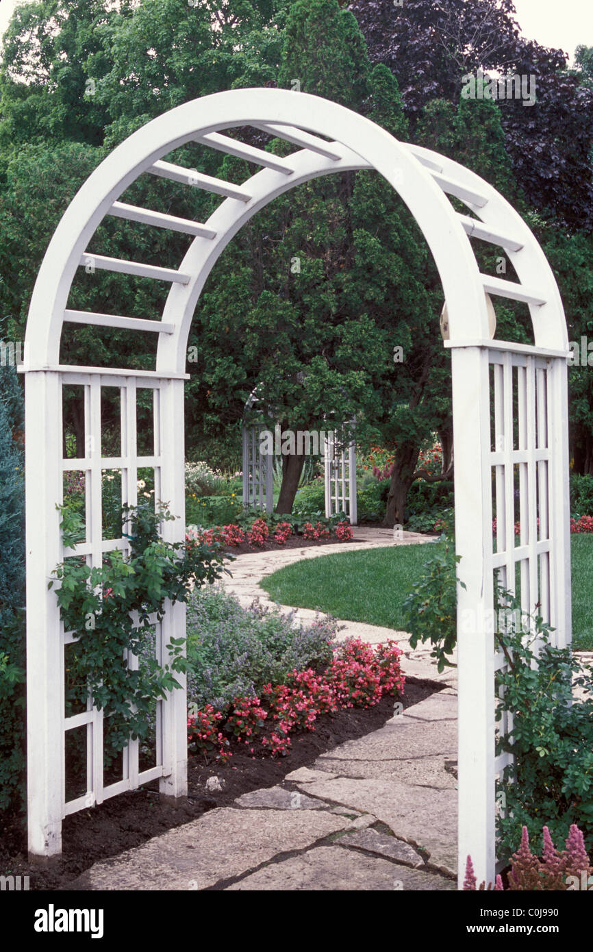 Merveilleux WHITE WOOD ARBOR FRAMES STONE PATHWAY IN MINNESOTA GARDEN. BEGONIAS AND  CATMINT BORDER PATH;