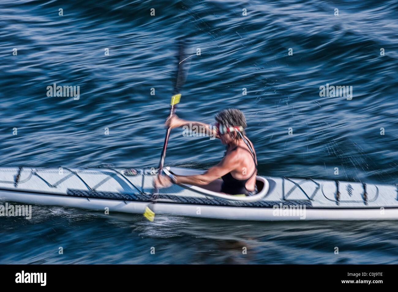 Person kayaking on Lake Union, Seattle, Washington, USA - Stock Image
