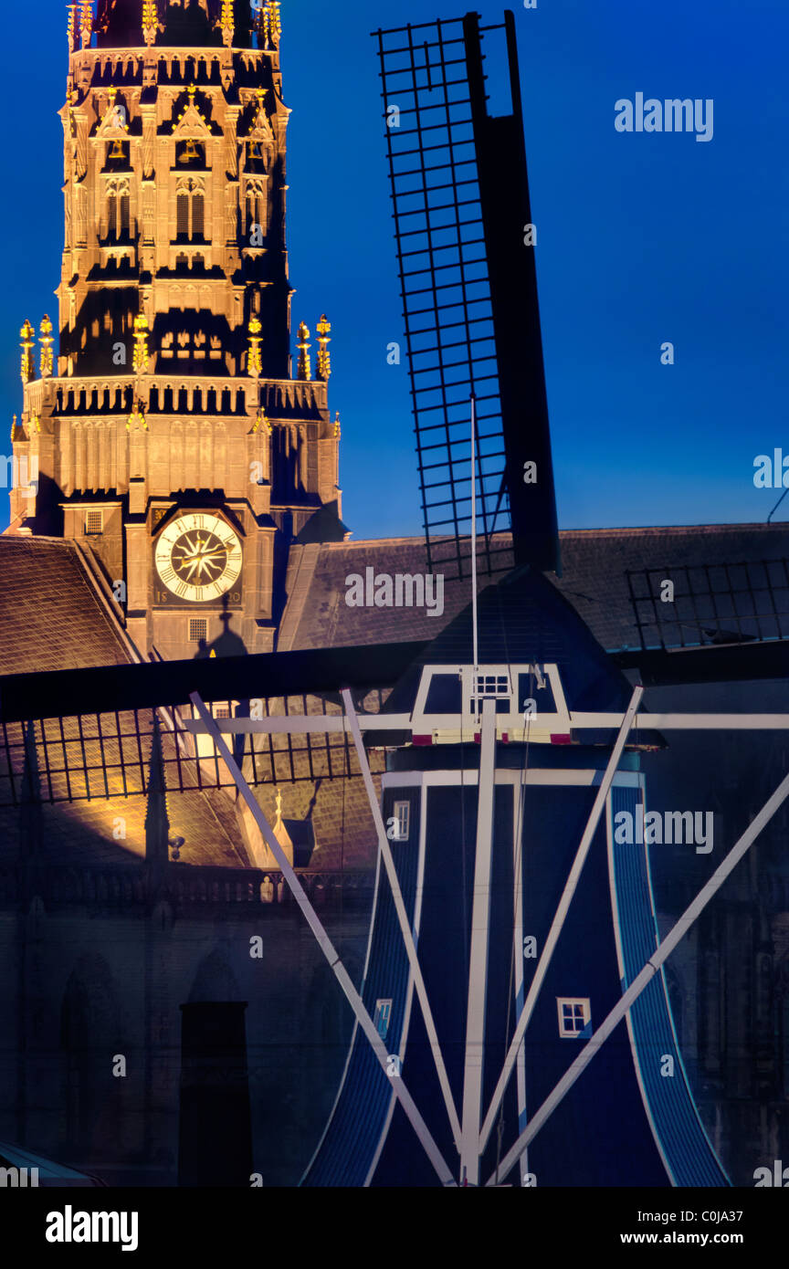 Haarlem landmarks Windmill De Adriaan and the Grote (Great) or Oude (Old) St Bavo church, cathedral and bell tower at dusk. Stock Photo