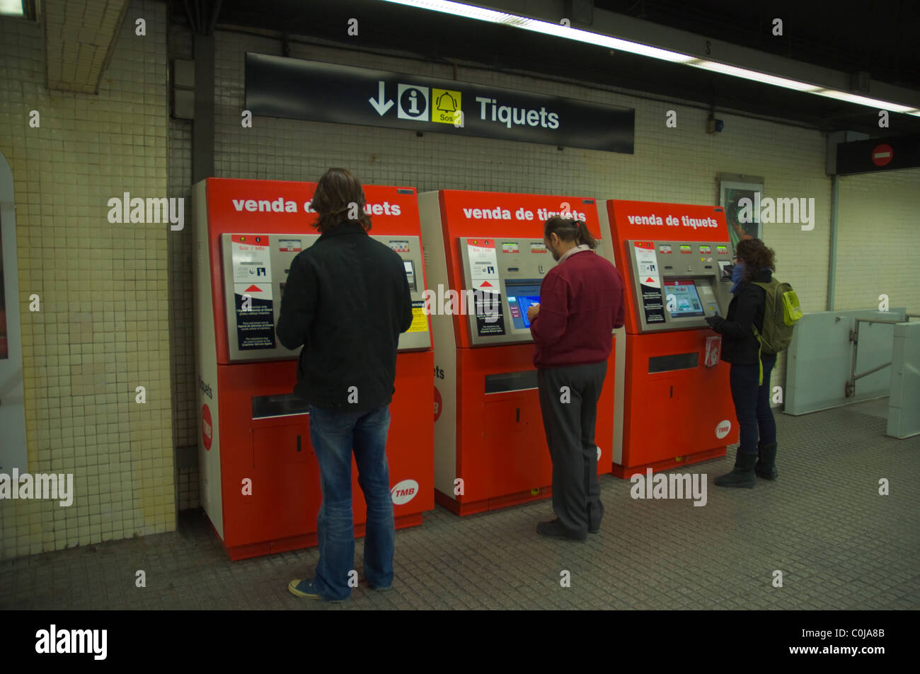 People buying tickets at Jaume I metro station central Barcelona Catalunya Spain Europe - Stock Image