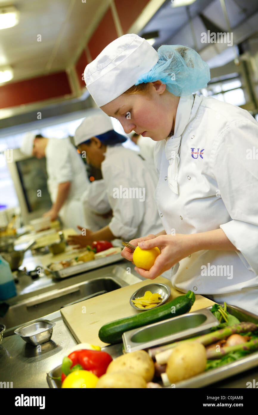 Student chefs learning to prepare food in a kitchen at Birmingham college, - Stock Image