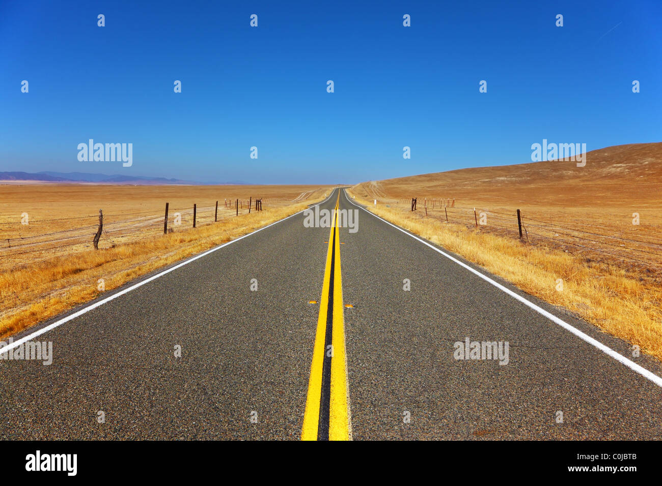 Travel to steppes on excellent American highway - Stock Image