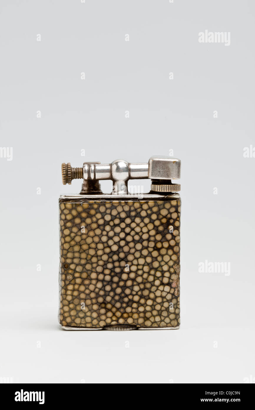 Shagreen (shark skin) cigarette lighter made by Dunhill (Parker Beacon). 1920s - Stock Image