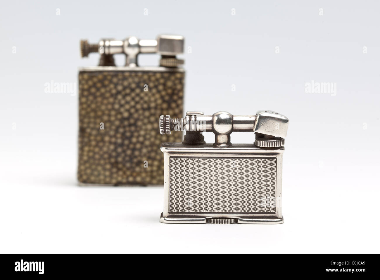 Two antique cigarette lighters made by Dunhill in the Parker Beacon range. (Selective focus) - Stock Image