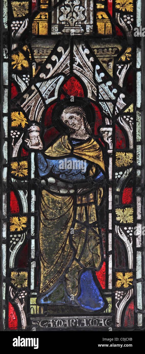 A 14th century stained glass window depicting St Mary Magdelene, St John Baptist Church, North Luffenham, Rutland - Stock Image
