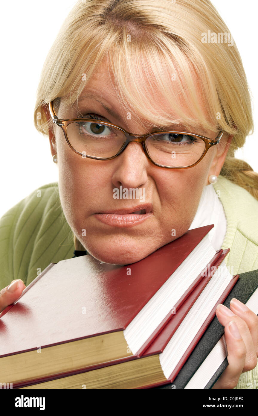 Disgruntled Bookworm School Girl with Her Books Isolated on a White Background. - Stock Image