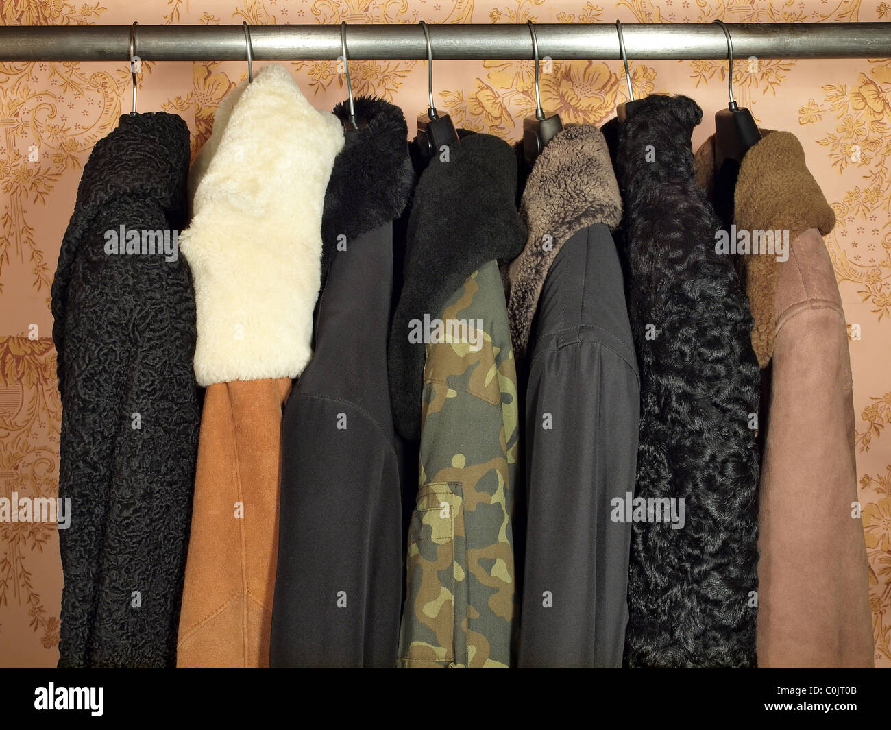 Winter clothes on a hanger in the closet. - Stock Image
