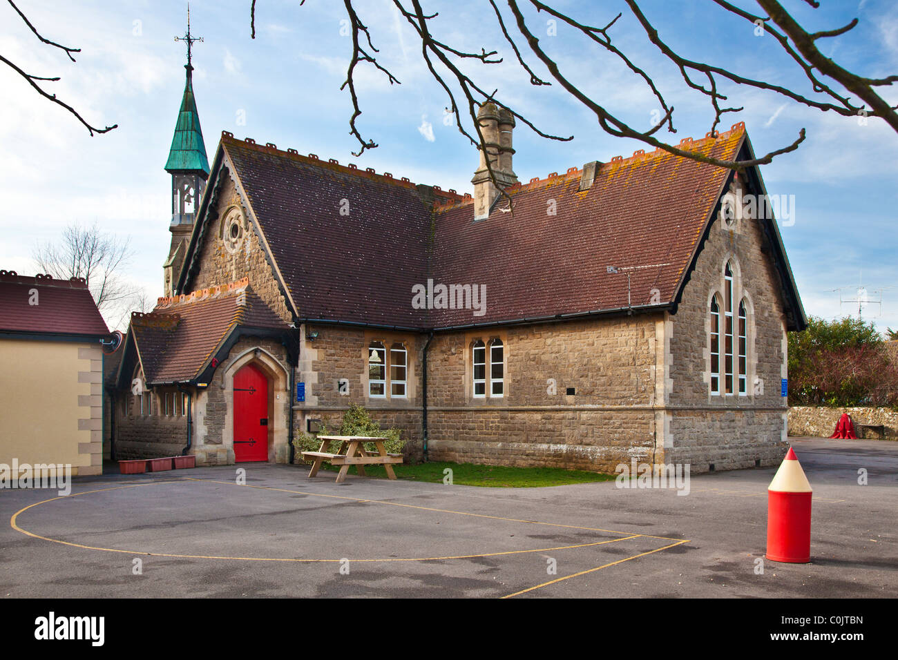 A typical English country primary school in the Wiltshire village of South Marston near Swindon, England, UK with - Stock Image