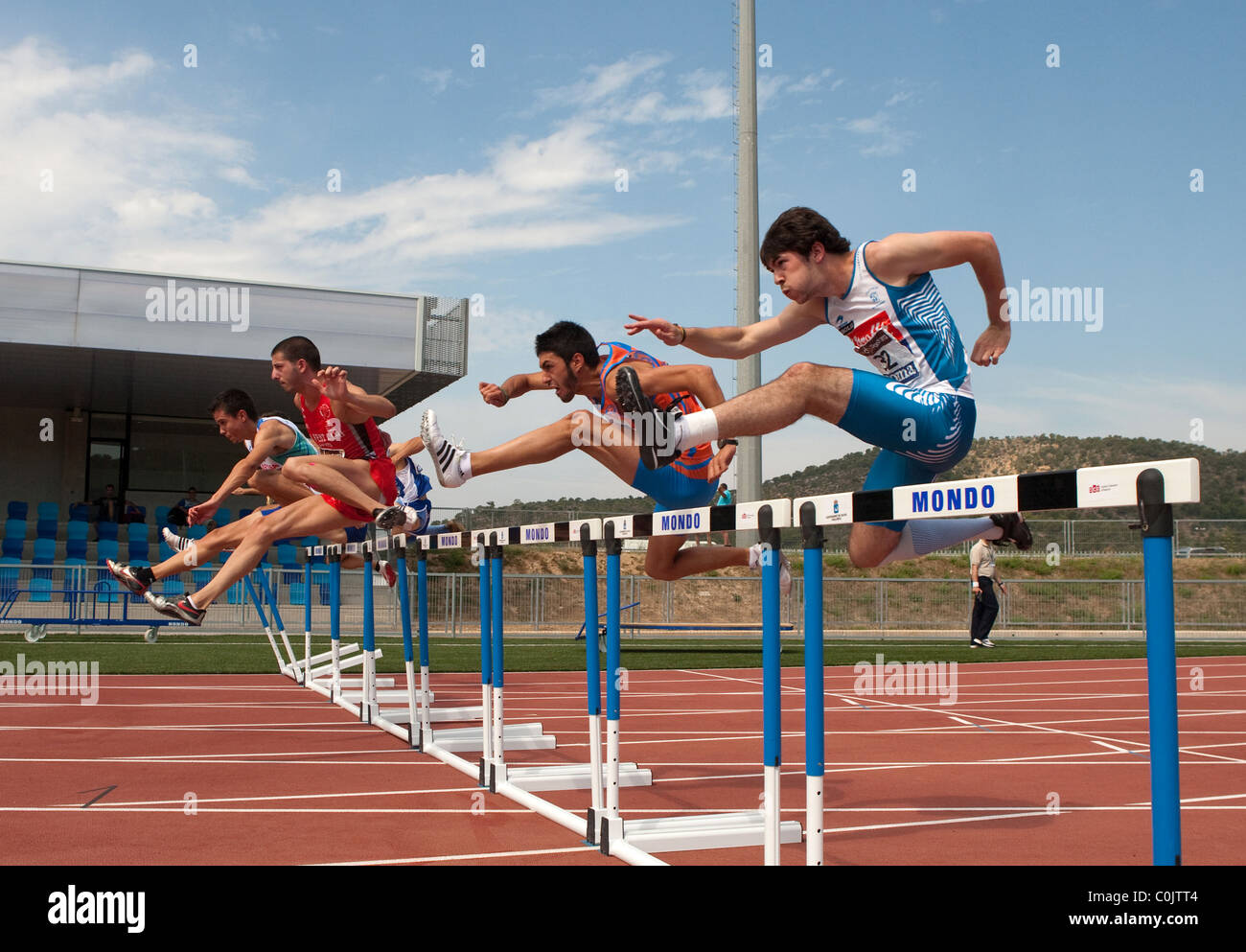 Sport outdoor Athletics competition race track adult athletes jumping. Championships of Spain, July 3rd 4th 2010 - Stock Image