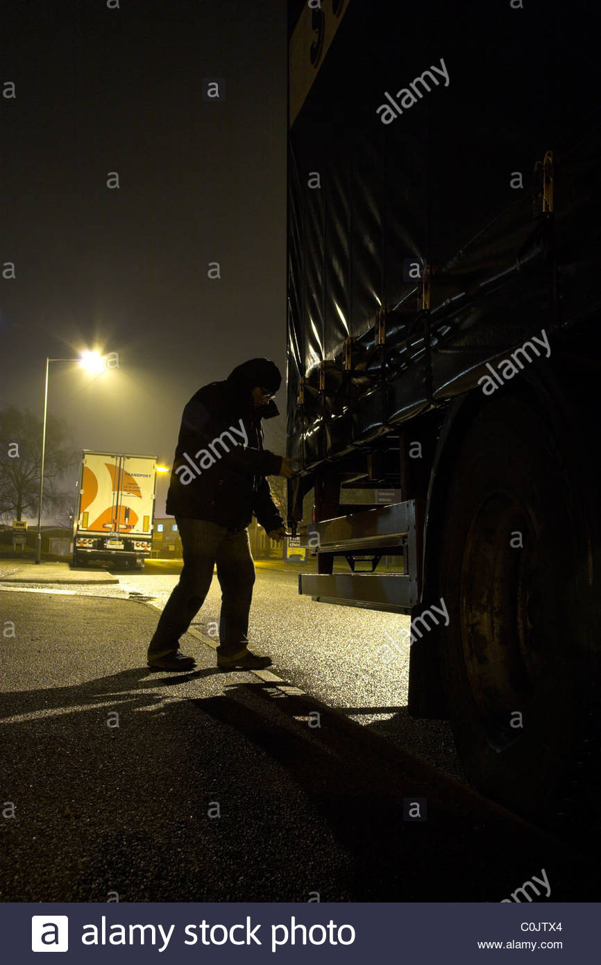 Truck crime / lorry load theft (posed by model),  UK. - Stock Image